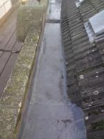 The existing lead valley was replaced. Also the timberwork and felt were renewed to the bottom 3 courses of tiles.