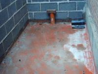 Installation of radon barrier prior to concreting the floor