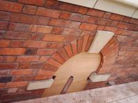 Detailed brick and stonework window arch