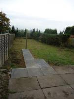 The existing patio slabs were extended to form footpath to new rotary dryer and line post.