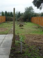 Showing strimmed grass and new fencing both sides.
